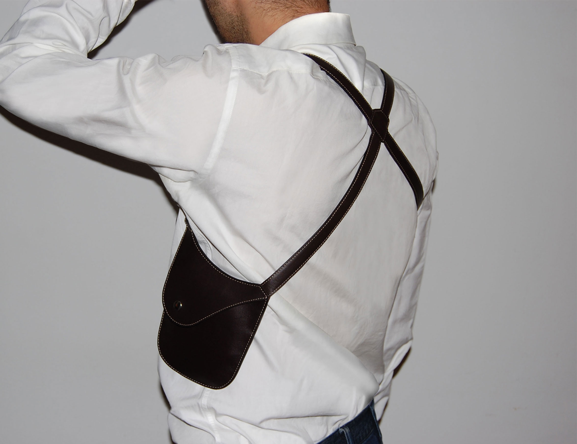 shoulder holster on white shirt